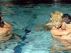 Two hot blondes enjoy ardent foursome sex near an indoor pool