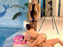 Two captivating brunettes Dorothy Black and Kathy Divan are getting naughty with some dude near an indoor pool. They suck and rub his schlong and then jump on it crazily by turns.
