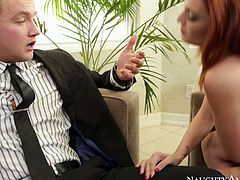 Awesome red haired cutie with sweet tits wears sexy tight black dress. This girlie gonna please her tired husband. Gorgeous slender hottie bows above the dick of the man in suit and sucks it passionately for sperm right on the couch.