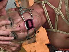Buxom blonde hangs suspended by ropes in hot threesome sex scene. While one stud drills her fanny from behind spoiled nympho starts sucking the other dick greedily.