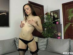 Pretty brunette chick Polly Sunshine is having fun with some dude indoors. She strips and shows him her small tits and then drives him crazy with a nice handjob.