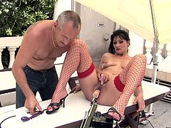 This brunette whore in red fishnet stockings spreads her legs wide and gets her juicy twat drilled with crazy drilling device. Press play and enjoy the show!
