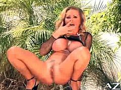 Dyanna Lauren is rubbing her tight snatch through her panties to tease you. Then she spreads her legs wider and starts toying it with her favorite dildo!