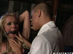 Short haired brunette domina gives bad times to a salty blondie with sheer long hair. She ties her with her mouth plugged before she starts pinning her body with clothing pegs in BDSM-styled sex video by 21 Sextury.