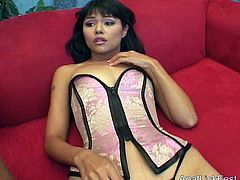 Tasty looking Latin cutie in pink and black satin corset sits on the couch speaking on cam before a ruined blonde joins her to rim her stinky anal hole in peppering FFM sex video by Pornstar.
