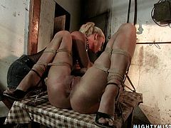 Horny blonde ties brunette hoochie up and teases her pussy. She likes to torture her and finger fucks her without mercy. watch thrilling BDSM sex tube scene for free.