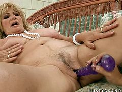 This young slut knows how to please her lesbian friend. She shoves dildo deep inside her snatch and starts pumping it in and out pushing her to the edge of powerful orgasm.