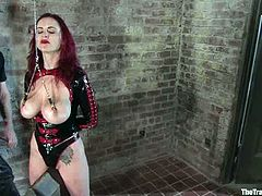 This is a very weird BDSM scene with a smoking tho redhead bitch Mz. Berlin. She loves being tortured and she gets a lot of pain in this BDSM session!
