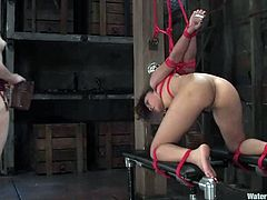 Petite Latin girl gets dominated by her mistress. She gets undressed and tied up. Later on she gets toyed with the strap-on from behind and tortured in an aquarium filled with cold water.