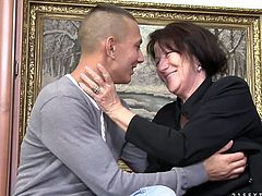 Whorish brunette mom picks up a sex hungry young dude in the street. They head to the park where they kiss with passion sitting on the bench before she lures him home.