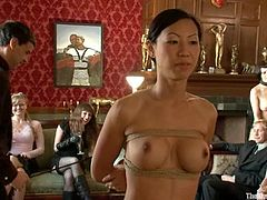 Kinky Asian girl gets tied up and toyed by group of people. Later on she sucks big black dicks and gets her pussy torn up.