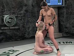 Kinky Sara Jane Ceylon loses a fight to Amber Rayne without any chance. So, she takes big dildo in her vagina as a punishment.