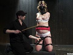 Lewd blonde mom Sofia Lauryn lets some guy put her into fetters in a basement. The dude play with Sofia's amazing boobs and then smashes her meaty cunt with a dildo.