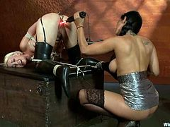 There's some pretty wild anal action in this lesbian BDSM video where Isis Love plays with submissive Dylan Ryan.