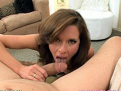 Sexy brown-haired milf Veronica Avluv strips and shows her big natural tits to some guy. Then she kneels in front of him and begins to suck and rub his dick remarcably well.
