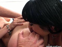 Spoiled blond MILF with long hair and heavy make up lies on her back getting soaking shaved pussy tongue fucked by rapacious brunette lesbian before they switch the roles in sultry lesbian sex video by Pornstar.