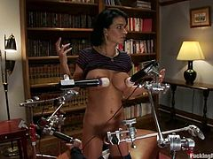 Captivating brunette Bailey Brooks is having fun with a fucking machine indoors. She lies down on the floor and gets her butt drilled remarcably well.