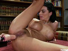 Bailey Brooks gets her ass pounded by a sex machine in a study