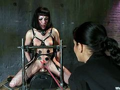 Hot brunette in fishnet stockings gets tied up by Isis Love, her mistress. After that she gets her pussy tortured with metal claws and electricity. Of course she also gets toyed with a strap-on and a vibrator.
