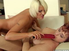 Are you into lesbian old young fuck scenes? Then, check out these feisty lovers playing with big dildo having passionately lesbo fuck on a couch.