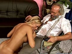 One of the charity projects of lascivious blond babe is fucking with handicapped daddies. This time she gives a head to one of them before she tops him for a ride reverse.