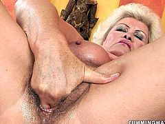 Voracious blond mom takes off her raunchy gold lingerie before she proceeds to rubbing her bushy cunt with fingers. Later she proceeds to riding a vase with her stretched punani.