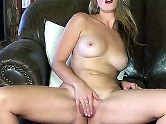 Mesmeric hottie with large melons Shae Snow loves to finger her yummy mooist pussy on a couch
