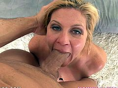 Cock hungry blonde woman with juicy tits comes up to a younger dude. She sucks his dick and also licks balls with great pleasure.