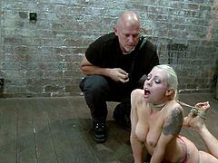 Tattooed blonde bitch Lorelei Lee is having fun with Mark Davis and some dominant bitch in a basement. Lorelei gets bound and suspended and then sucks Mark's cock and gets her cunt toyed.