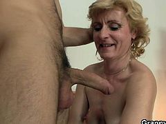 See a nasty blonde granny sucking and riding a young stud's cock with her ass in this intense old-young video.