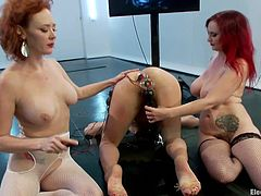 Bent over and with her ass at complete disposal Bianca obeys her sensual redheads. The devilish whores enjoy to punish and sexual exploit Bianca, taking their time to play with her ass. They've inserted electric plugs in her ass, shocked her butt and had a great time together. Only redheads can have fun like that!