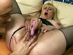 Outrageous gray hooker with fat ass and hairy cunt is greased up. Perverted dude fingers her clam at first. Then he pleases her mound with various sex toys.