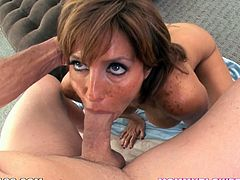 Slutty redhead mom Tara Holiday strips and shows her big ass and massive natural tits to some guy. Then she kneels in front of him and favours him with a terrific deepthroat blowjob.