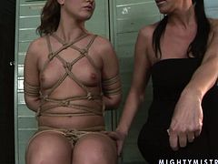 Ample MILF gets bandaged tight by insatiable mistress before she takes clothings pegs, which she pins to her curvy frame and tits in BDSM-involved sex video by 21 Sextury.