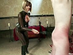 There's all sort of kinky femdom stuff going on in this bondage video with Maitresse Madeline who has fun in many ways with this guy.