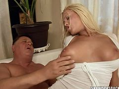 Mind taking blond busty babe in provocative nurse costume pleases her overaged sugar daddy. She gives his oversized penis a blowjob before riding it reverse and later switching to doggy position.