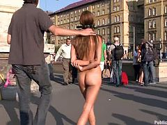 Beautiful brown-haired chick Alice Romain is having a good time with some guy. The man undresses Alice and makes her walk nude down the street before he fucks her nice pussy behind the corner.