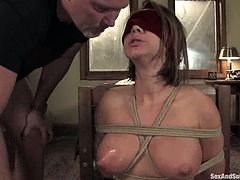 This desirable and smoking hot siren Camryn Kiss is being inflicted to the BDSM fantasies of Mark Davis. Man, this honey loves a lot of pain!