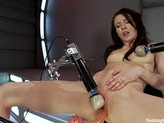 Sexy brunette Aiden Ashley is playing with a fucking machine indoors. She strokes her hot body and then gets her holes pounded by the device.
