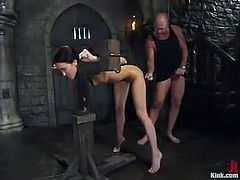 Jamie Huxley is the pretty and sexy brunette having rough hardcore sex in a bondage and domination session where her pussy is fucked hard.