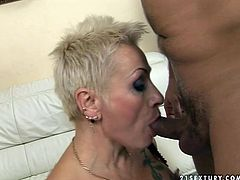 This whore loves the taste of meaty cock in her slutty mouth. So she gets down on her knees and does what she does best. She sucks her boyfriend's stiff dick greedily like a true cock sucker. Then she wants something in return. She lifts her legs up to let her lover enjoy the taste of her juicy pussy.