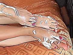Hot bisexual threesome and footjobs