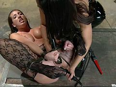 Sexy brown-haired chick Kelly Divine allows Isis Love to tie her up and beat her with a lash. Then Isis attaches wires to Kelly's butt and fucks her hot pussy with a strapon.