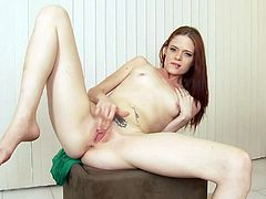 A cute redhead drops her panties and starts fingering her gorgeous pink pussy for the camera, hit play and check it out!