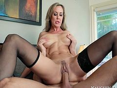 Well figured mom Brandi Love with perfectly rounded silicon boobs is getting hammered bad in her twat from behind. She is keeping her legs closed so the pussy hole feels tighter. Later in the video, Brandi gets on top of hard shaft riding it furiously.