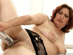 Immense red-haired mature BBW sits in the hot tub sucking a baseball batt before she starts pounding her nasty looking hairy snatch in peppering sex video by 21 Sextury.