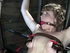 Slutty milf Layla Kay shows her cunt to Princess Donna Dolore and lets her attach wires to it and rub it with a toy. Then Donna attaches a strapon to her thighs and fucks Layla's twat deep and hard.