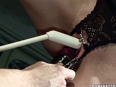Sophisticated master comes up with all kinds of tortures for a foxy dark haired babe. HE ties her with rope to the ceiling with mouth gag in her mouth before he pins her pussy lips with metal clips and later pokes her snatch with sex toy in BDSM-involved sex video by 21 Sextury.