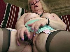 Although she had a lot of fucking action at her life Amanda still needs to masturbates. She's an experienced mature lady that enjoys acting like a slut when she's alone. The blonde whore makes herself comfortable on the couch and fucks her shaved pussy with that dildo in different positions