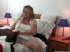 Isabel is a horny grandma with mega tits. She tries on clothes, including fishnet tights that she keeps on when she pleasures herself with a vibrator.